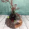 Herfstdecoratie op rieten schild