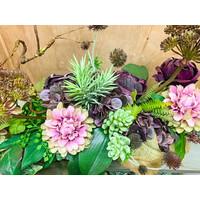 Zijden bloemstuk paars