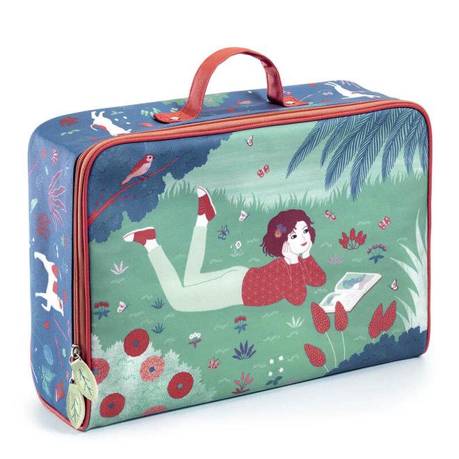 Koffer dromen in het gras