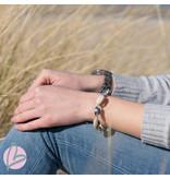 Beadle armband met zilveren en echte cowrie schelpjes