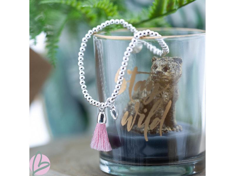 Biba Zilverkleurige metalen armband met roze kwastje