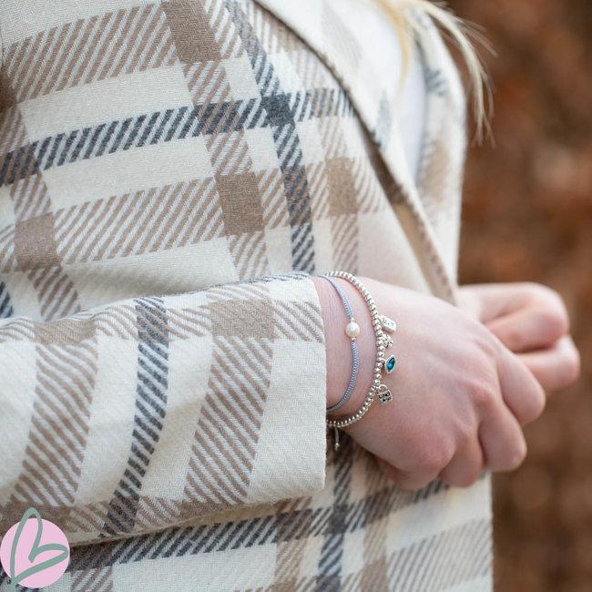 Beadle Grijze koord macrame armband met parel