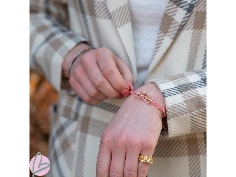 Biba Roze knoop armband met roze en gouden kralen