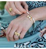 Biba Biba witte zoetwaterparel armband met zeester en schelp in goud