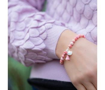 Biba Roze kralenarmband met kwast en schelp