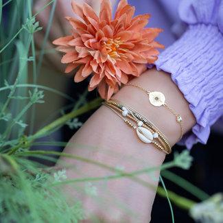 ZAG  Bijoux Gouden armband met ster en dubbele armband met schelpje