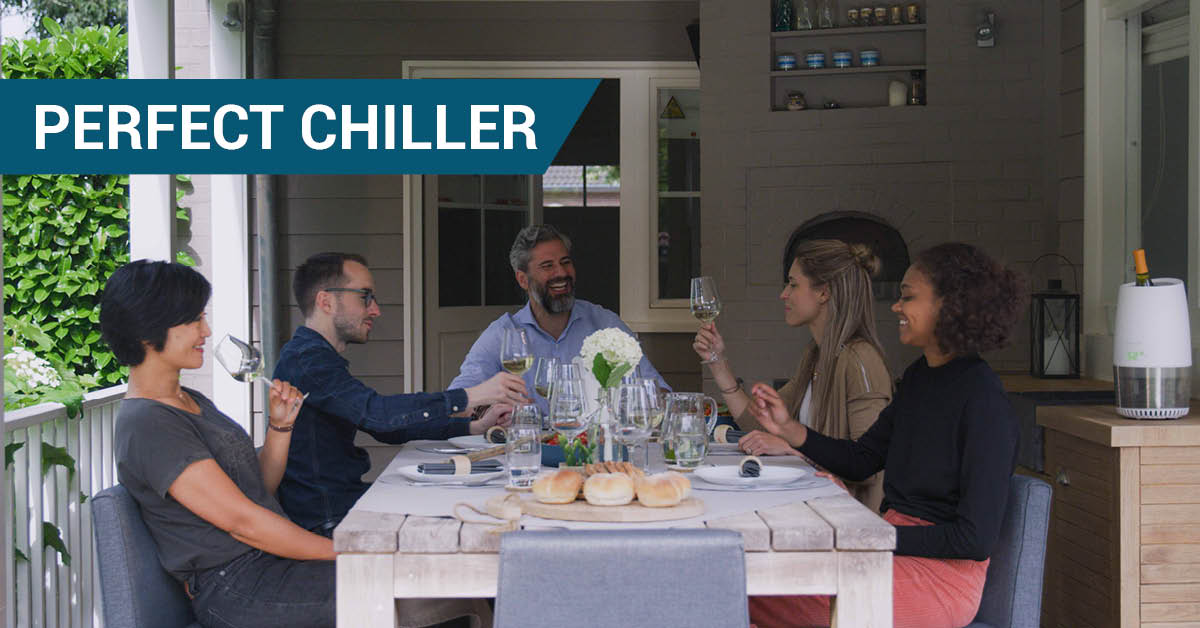 People drinking wine with the wine cooler, as the perfect chiller on the table.