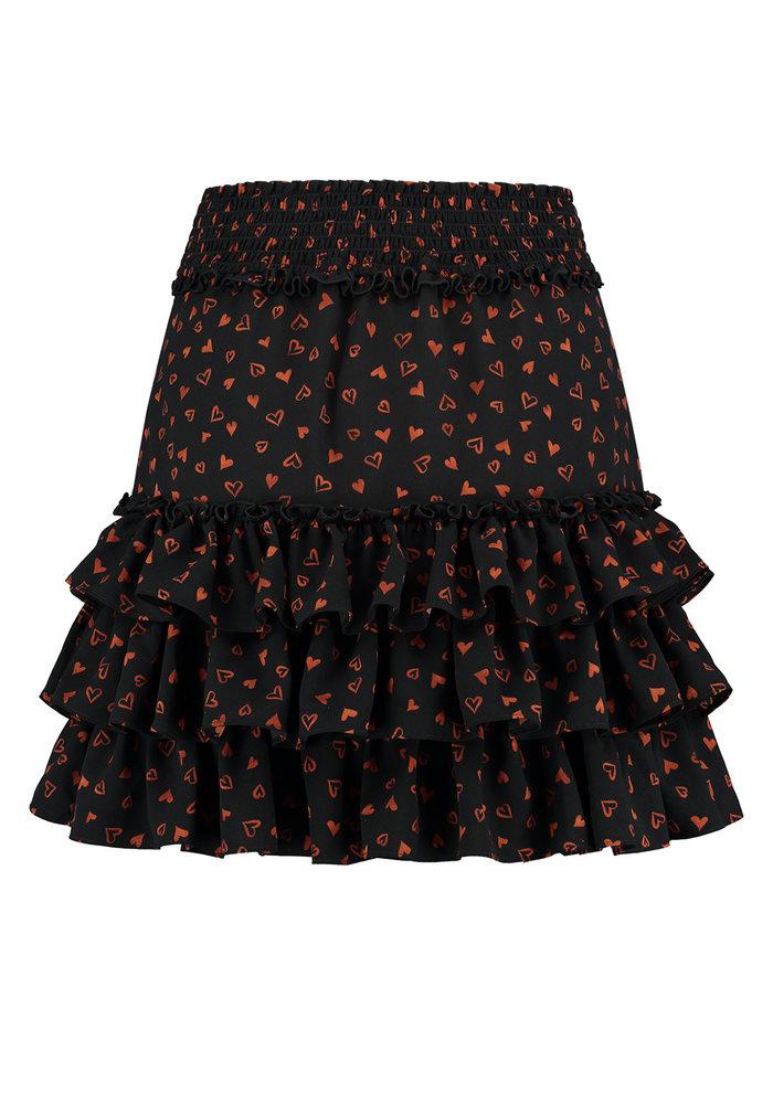 NIKKIE SIENA RUFFLE SKIRT Black skirt with all-over print