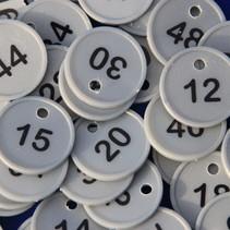 Genummerde Ø29 mm munten met gat