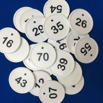 Genummerde Ø29 mm munten met stip