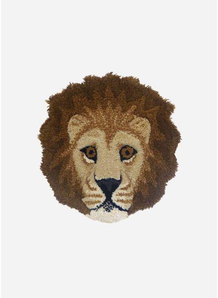 moody lion head rug
