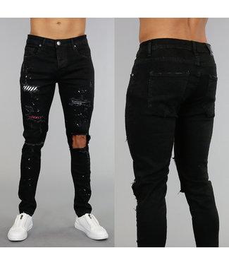 Zwarte Stretch Jeans met Scheuren en Verfspatten
