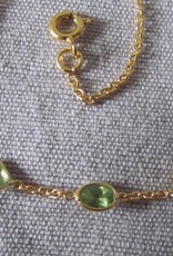 Necklace gold on silver and peridot stones
