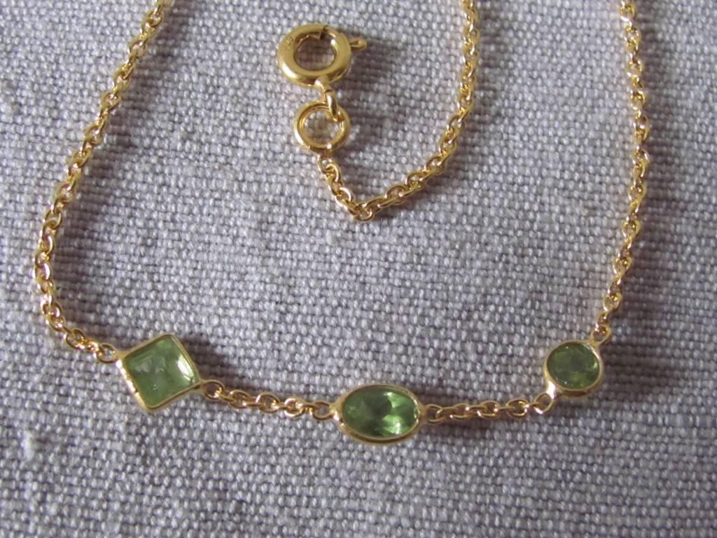 Halsketting goud op zilver en peridot stenen