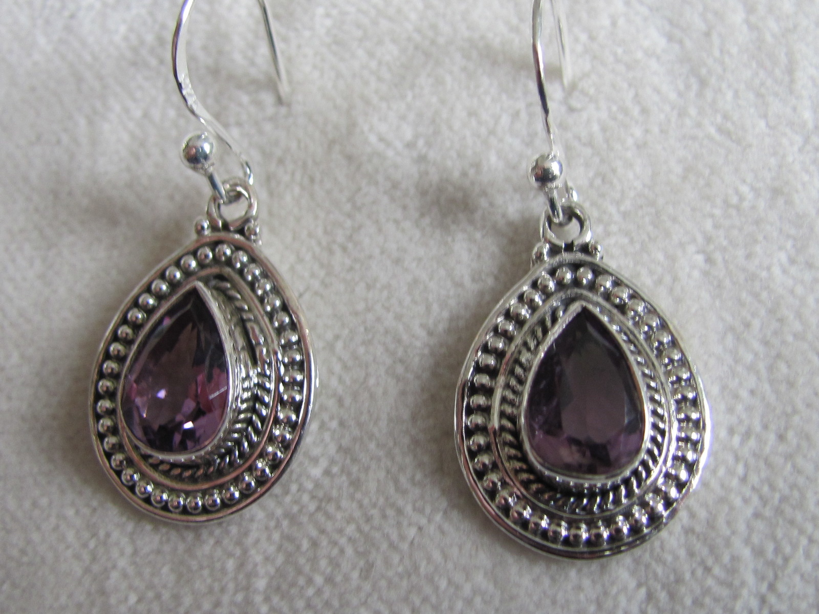 Earring silver with hand faceted   amethyst stone