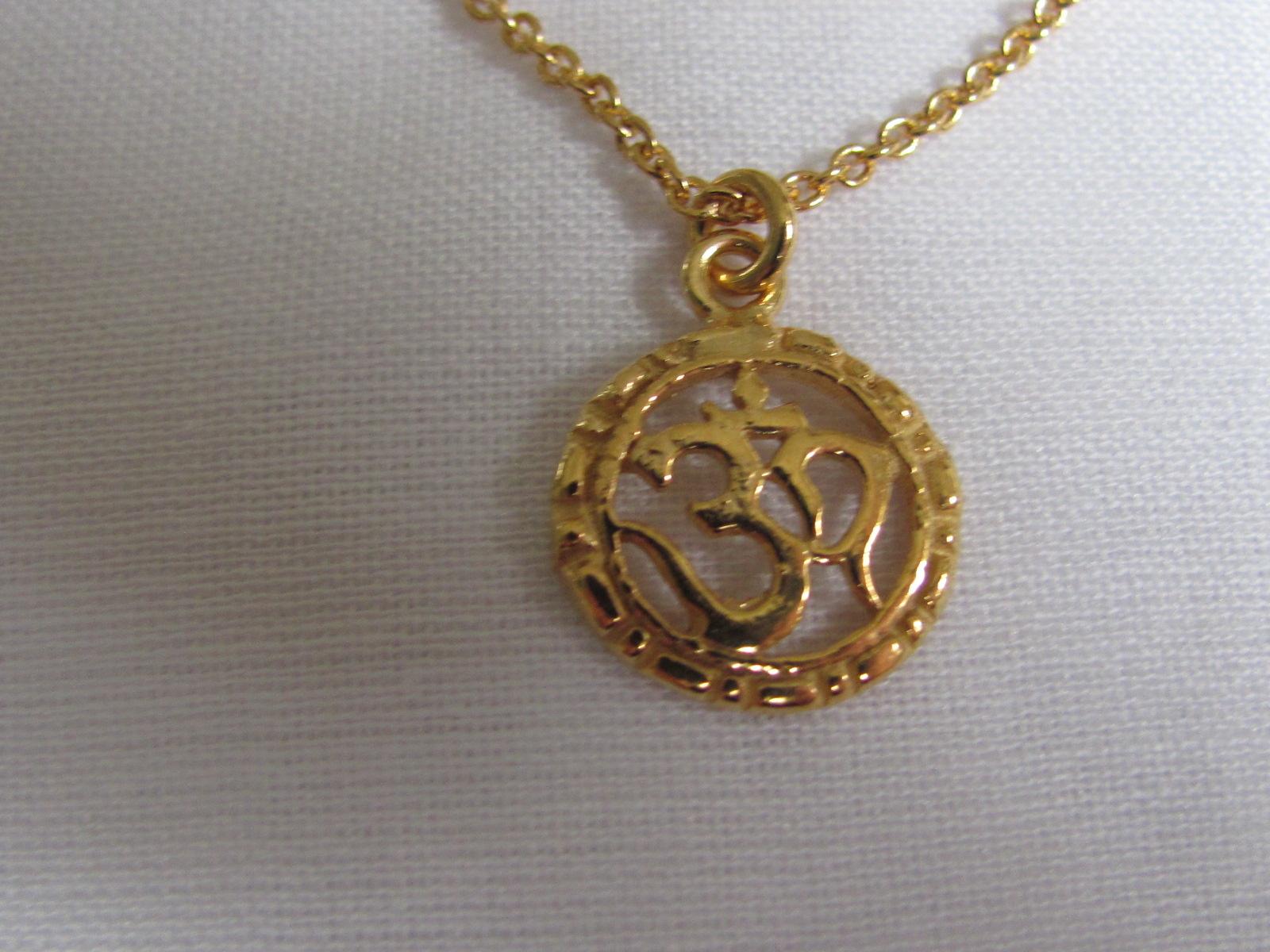 Halsketting  goud op zilver met OHM bedeltje