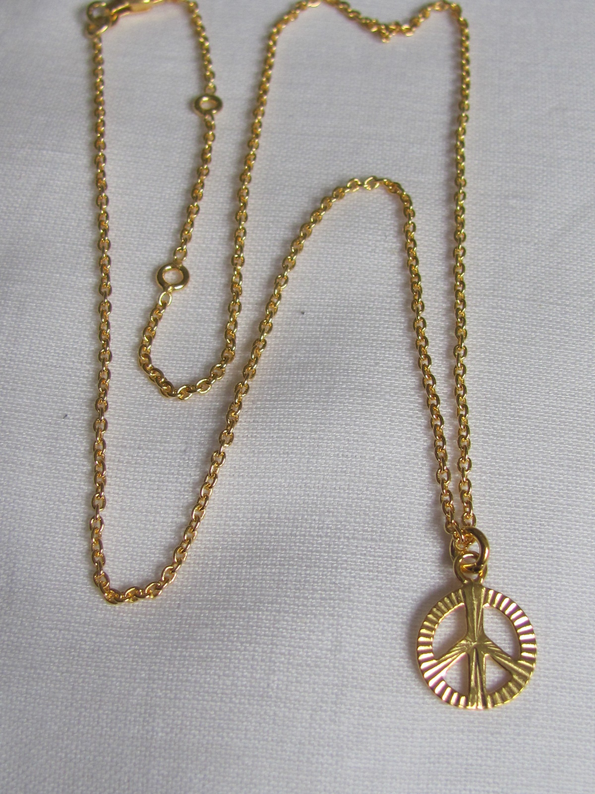 Necklace gold on silver with peace pendant charm