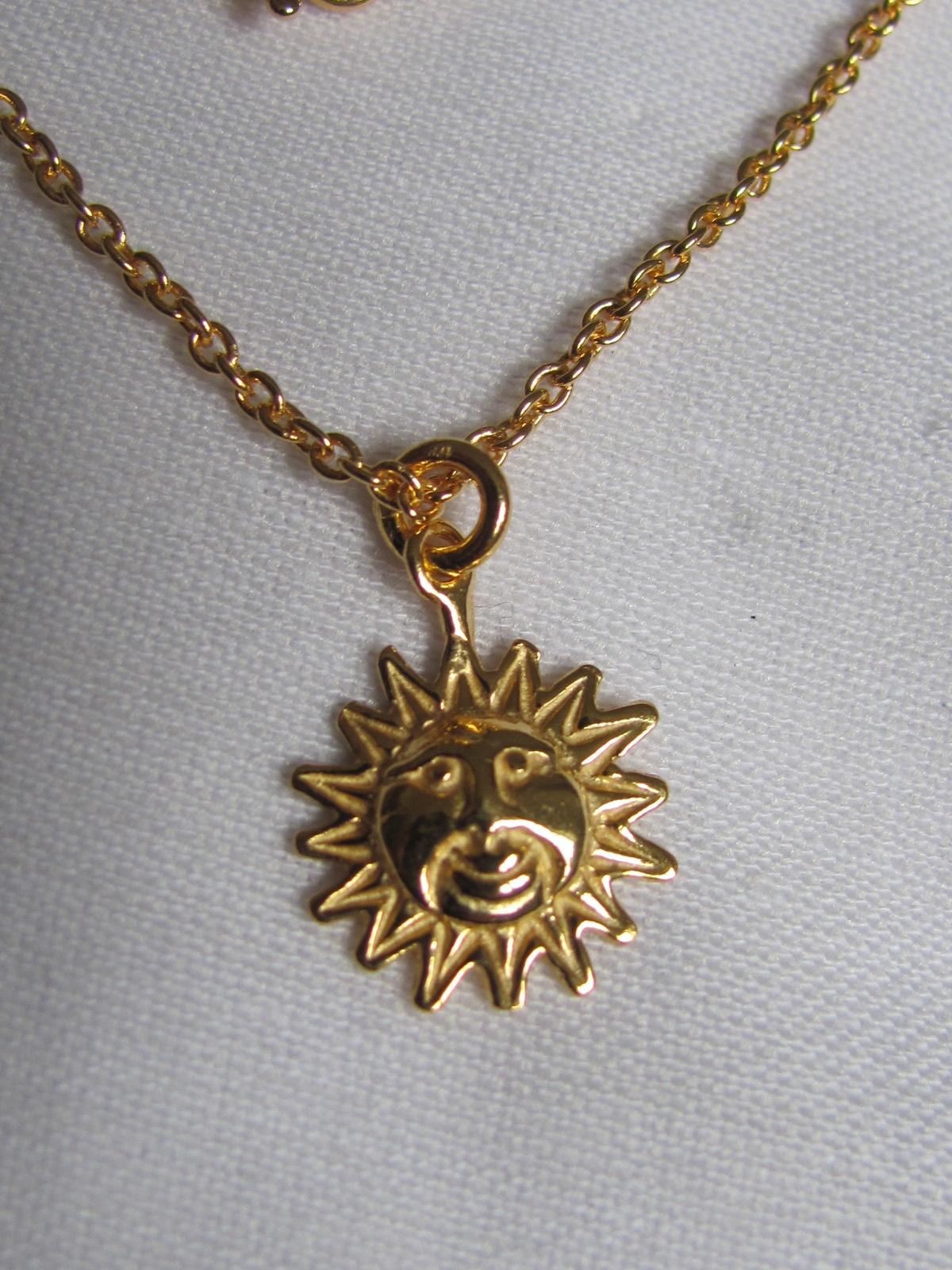 Halsketting  goud op zilver met zon bedeltje