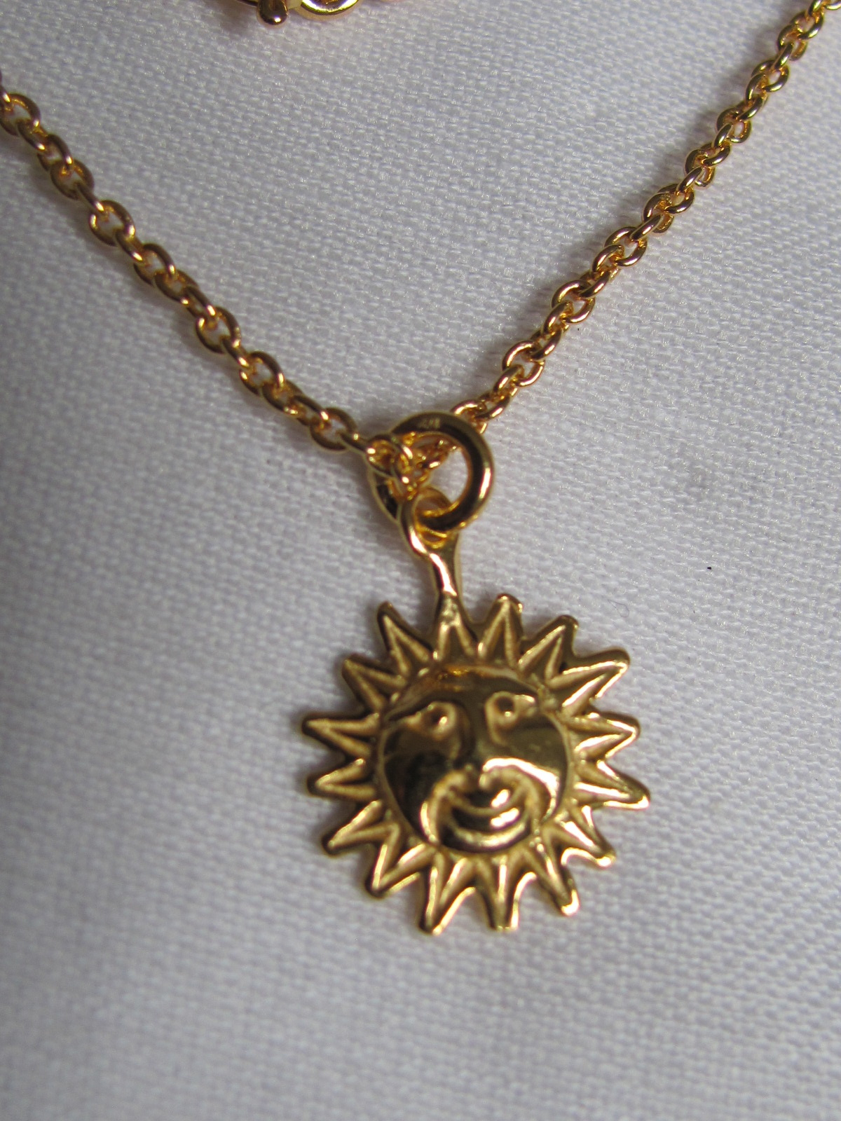 Necklace gold on silver sun charm pendant