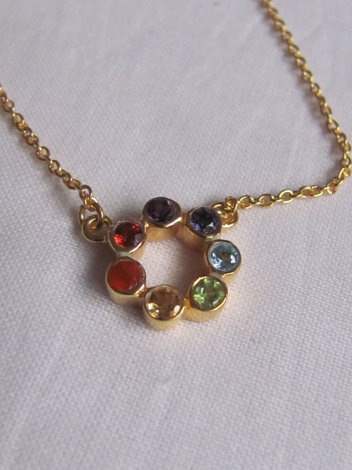 Necklace gold on silver with precious stones