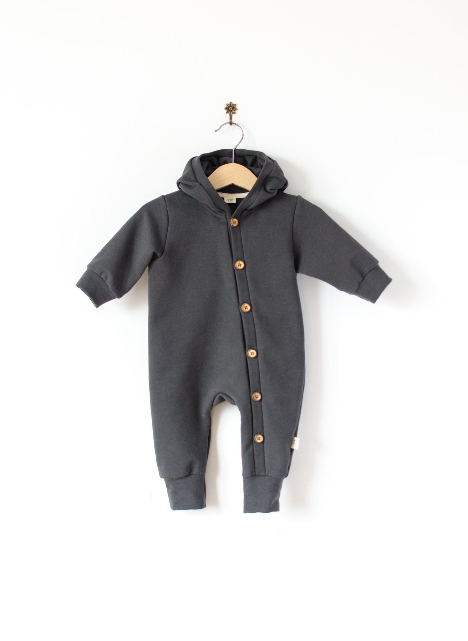 Baby Hooded jumpsuit nearly black with wooden buttons