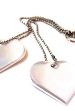 Réflecteur avec deux coeurs blancs
