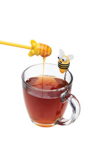 Thee-infuser bij met honinglepel
