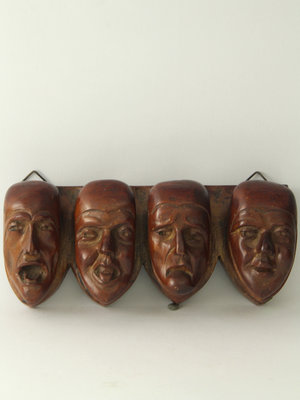 Amsterdam Pipe Museum Wall rack with carved character heads