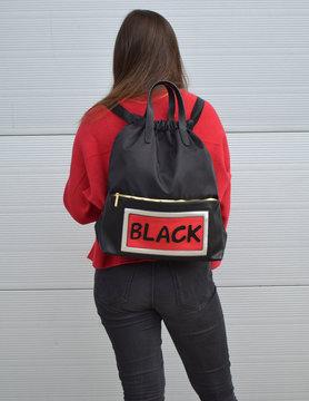 Black rugtas