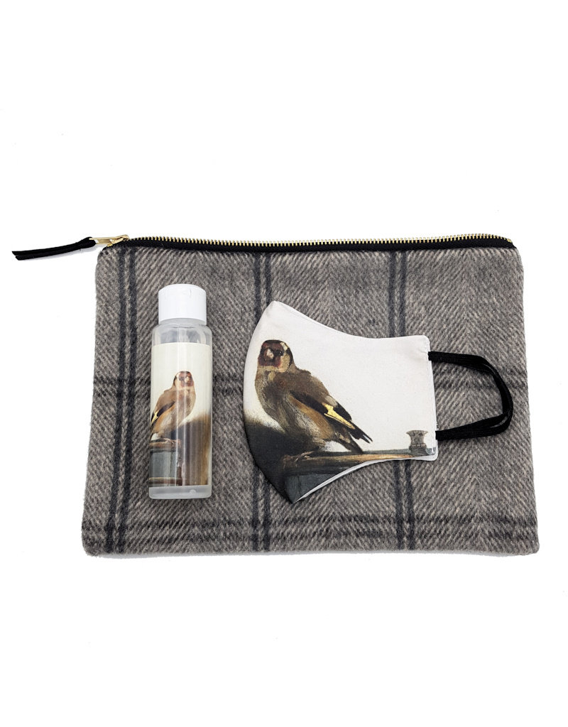 Toiletry bag gray checkered filled with face mask and hand gel