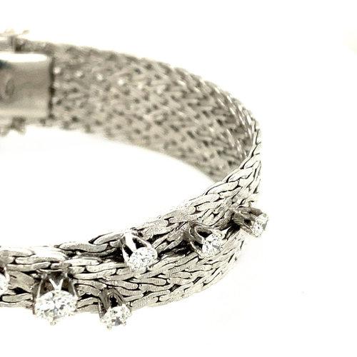 White gold braided bracelet with diamond 14 krt