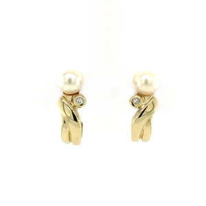 Gold ear studs with pearl and diamond 14 krt