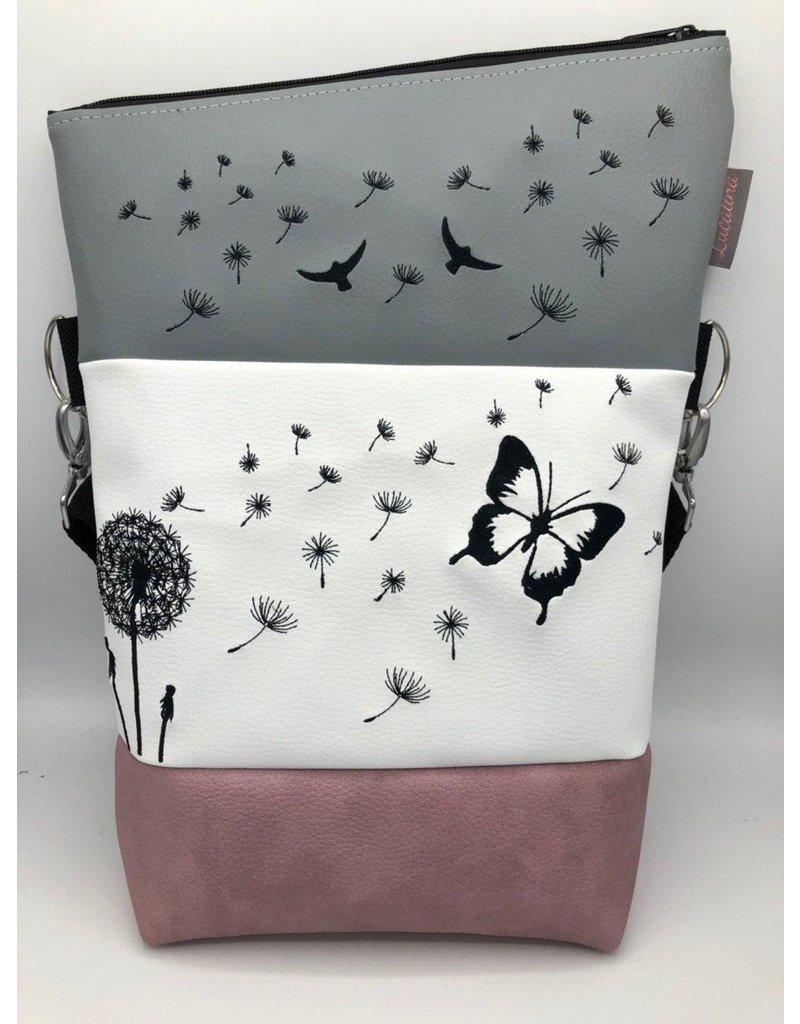 Foldover Pusteblume mit einem Schmetterling
