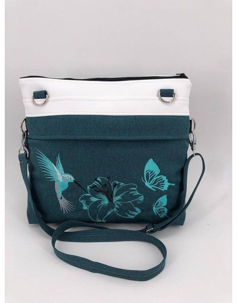 Frühlingsliebe Kolibri mit Lilie und Schmetterlingen