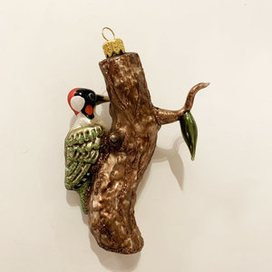 Christmas Decoration Woodpecker on a Trunk