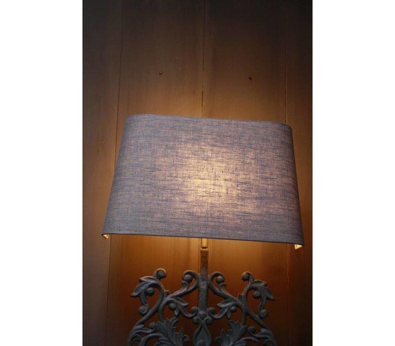 Staande ijzeren lamp met grijze linnen kap