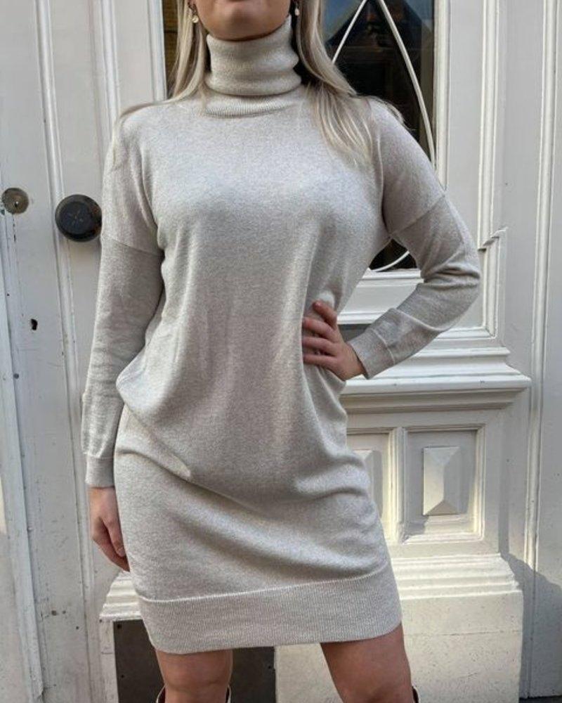 Glitter jurk met hoge hals