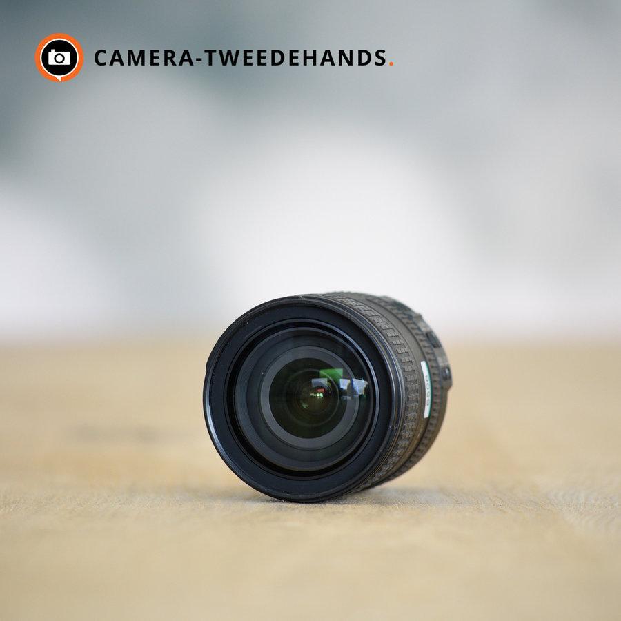 Nikon 16-85mm 3.5-5.6 G VR ED DX -- Met zonnekap