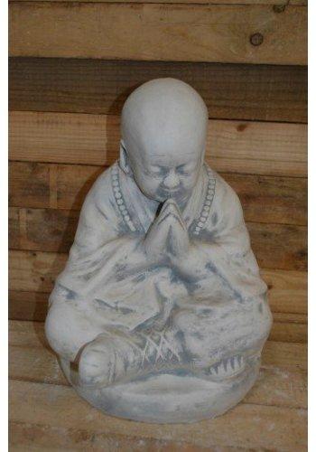 Monnik biddend