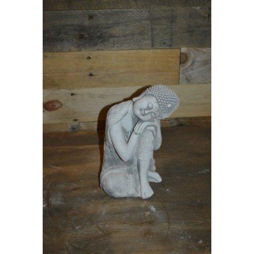 Boeddha beeldje met hoofd op de knie