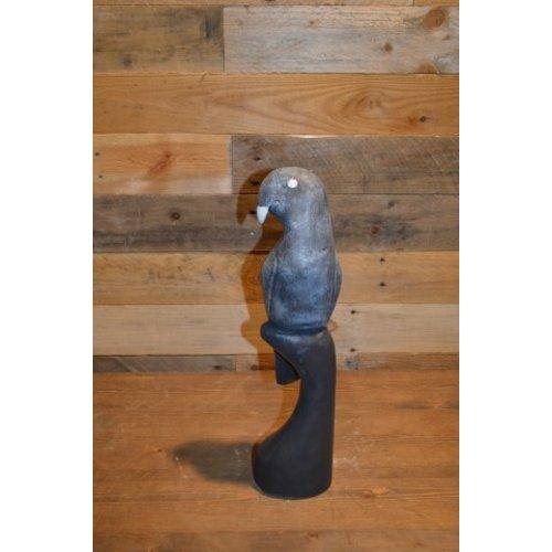 Vogel zittende op een paal