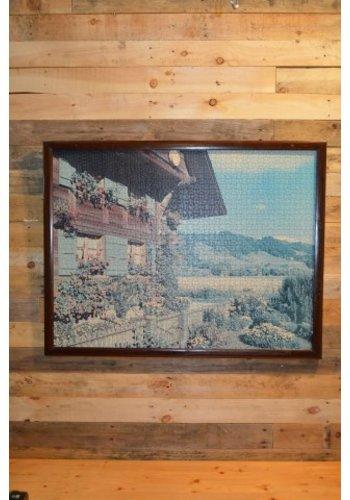 Schilderij van een puzzel Tiroler huis