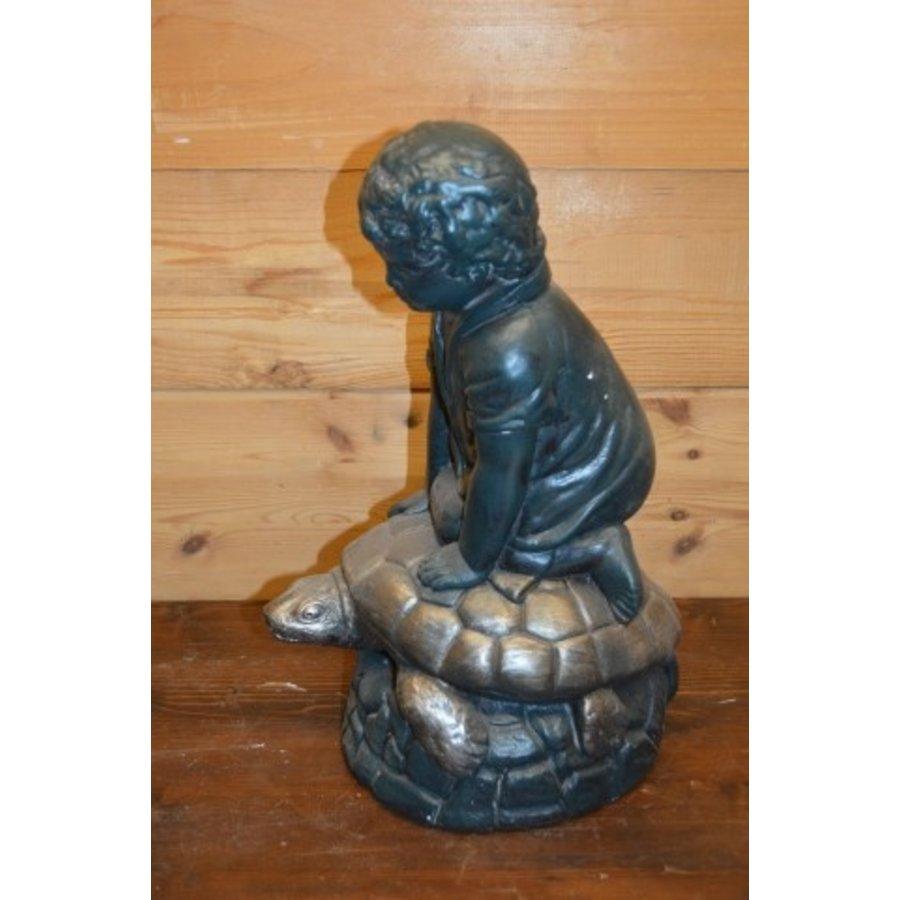 Jongen op schildpad-2