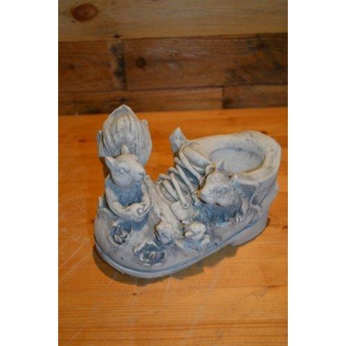 Eekhoorntjes op een schoen