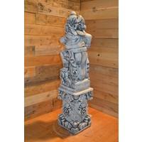 thumb-Balinese tempelwachter links kijkend + pilaar-4