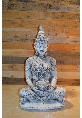 Shiva god met een bloemen schaaltje