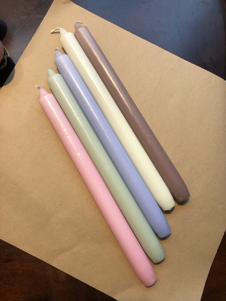 A package with 10 pastel coloured candles