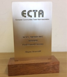 ECTA award in aluminum with wooden base