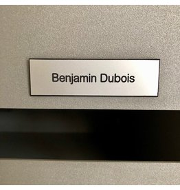 Nameplate in silver colored plastic