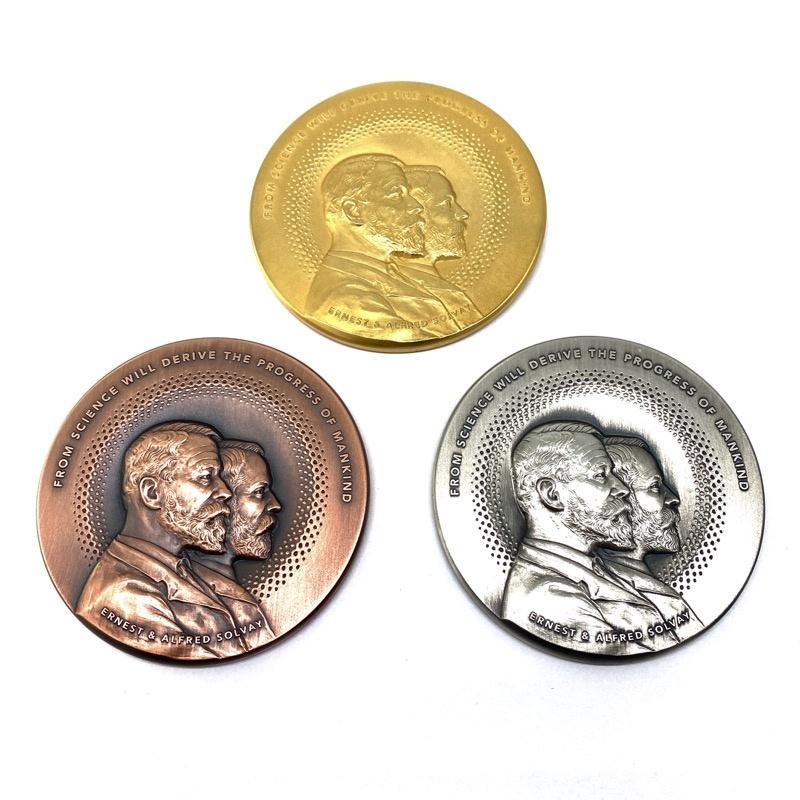 Medaille Solvay in goud - zilver - brons